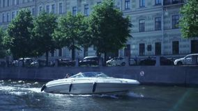 High-speed boat goes through the canals of St. Petersburg. slow motion, 1920x1080, full hd. High-speed boat goes through the canals of St. Petersburg stock footage