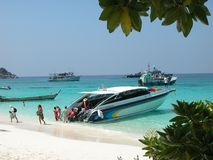 High speed boat at Similan Island. A high speed motor boat brings a group of tourists to one of the Similan Islands in Thailand Royalty Free Stock Photography