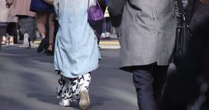 A high speed of body parts of walking people at urban city in Shinjuku
