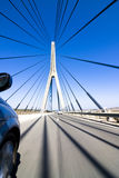 High speed on the bridge. Wide angle driving over a bridge at high speed. Focus on bridge tower Royalty Free Stock Image