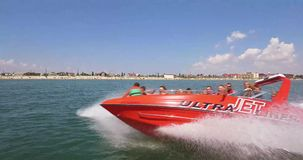 Speed and sea. A high-speed bright boat at high speed sail past the camera leaving a foamy footprint. Passenger boat is delighted stock footage