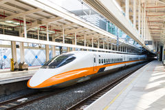 High speed bullet train by the railway station in Taiwan Stock Photography