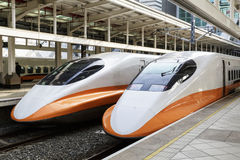 High speed bullet trains. Two high speed bullet trains next to platforms in a railway station, Taiwan Stock Photo