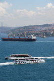 High speed commuter ferries criss cross the Bosphorus Royalty Free Stock Photography