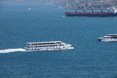 High speed commuter ferries criss cross the Bosphorus Stock Images