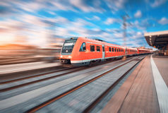 High speed commuter train in motion at the railway station Royalty Free Stock Image