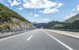 High-speed country road among the mountains. Stock Photography