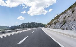 High-speed country road among the mountains. Stock Image