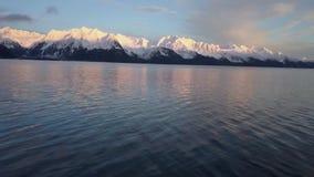 Drone flight over Alaskan water. High speed drone flight over Resurrection bay in Seward Alaska during the evening stock footage