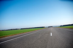 High-speed empty highway in a bright sunny day Royalty Free Stock Photography