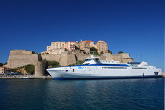 High speed ferry moored in front of citadel Stock Photography