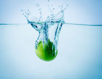 High speed freeze action shot of a lime splashing Royalty Free Stock Photo