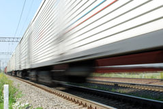 High-speed freight train. Movement freight train on the railroad Royalty Free Stock Photography