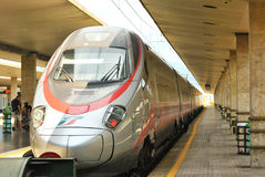 High speed italian train Frecciargento in a station royalty free stock image