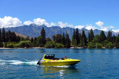 High speed jet boat on the Lake Wakatipuin the South Island of New Zealand Royalty Free Stock Images