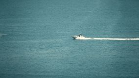 High speed motorboat moves at sea. High speed motor boat moves at sea royalty free stock images
