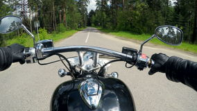 High speed motorcycle ride, handlebar close up. Forest background stock video