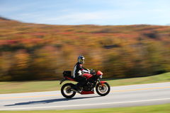 High speed motorcyclist on autumn background Royalty Free Stock Image