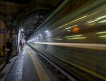 High-speed night train passing through a train station royalty free stock images