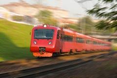 High-speed passenger train. Red high-speed passenger train in motion Stock Photos