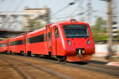 High-speed passenger train in motion. Red high-speed passenger train in motion Royalty Free Stock Photo