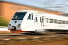 High-speed passenger train in motion. White high-speed passenger train in motion Royalty Free Stock Images