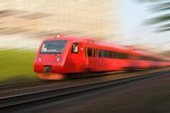 High-speed passenger train in motion. Red high-speed passenger train in motion Stock Image