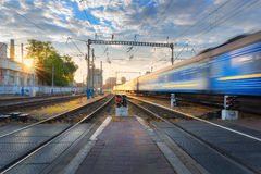 High speed passenger train in motion on railroad Stock Photo
