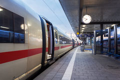 High speed passenger train on railroad platform. Railway station Royalty Free Stock Photos