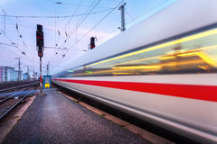 High speed passenger train on railroad track in motion Stock Image
