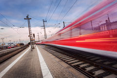High speed passenger train on railroad track in motion Royalty Free Stock Image