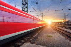 High speed passenger train on railroad track in motion Royalty Free Stock Photo