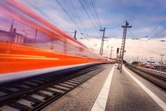 High speed passenger train on railroad track in motion Royalty Free Stock Photography