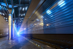 High speed passenger train on tracks with motion blur effect at Royalty Free Stock Photos