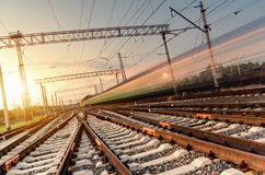 High speed passenger train on tracks with motion blur effect. At sunset. Railway station in Ukraine stock photos
