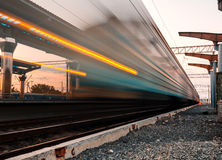 High speed passenger train on tracks with motion blur effect Stock Photography