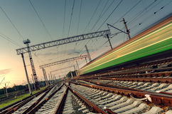 High speed passenger train on tracks with motion blur effect Royalty Free Stock Photography