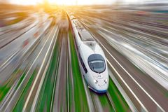 High-speed passenger train travels at high speed railroad green grass. Top view with motion effect, greased background. Stock Images