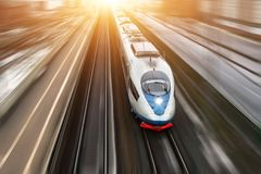 High-speed passenger train travels at high speed. Top view with motion effect, greased background. Royalty Free Stock Photography