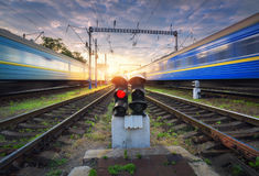 High speed passenger trains in motion on railroad track Royalty Free Stock Images