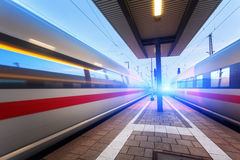 High speed passenger trains on railroad platform in motion Stock Photos