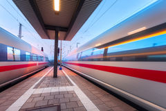 High speed passenger trains on railroad platform in motion Royalty Free Stock Photos