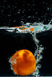 High speed photography of orange  with splash in water Stock Photo