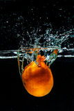 High speed photography of orange  with splash in water Royalty Free Stock Photography