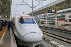 High-speed rail HSR in China with bullet head train very fastest speed stock photography