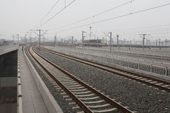 High-speed rail at railroad metal track with track. Bed royalty free stock photos