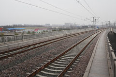 High-speed rail at railroad metal track with track. Bed royalty free stock photography