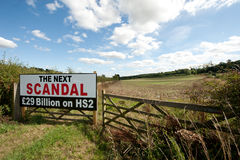 High Speed Rail sign. High Speed Rail 2 Scandal sign (HS2) in a field in Buckinghamshire Royalty Free Stock Photos