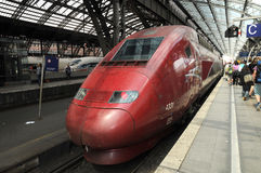 High-speed railway  Thalys in Cologne. Thalys is an international high-speed train operator originally built around the high-speed line between Paris and Royalty Free Stock Photo