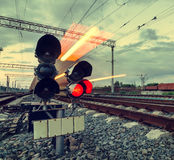 High-speed railway train with motion blur and railway traffic lights Royalty Free Stock Photos